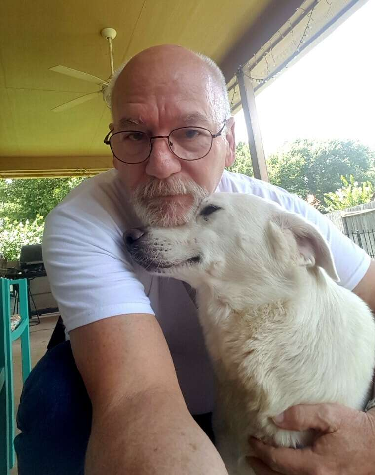 Dr. Michael White and his foster dog Janelle