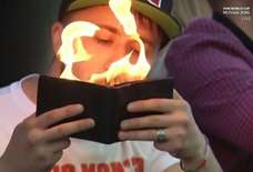 This Dude Lit a Cigarette With a Flaming Wallet at the World Cup & Everyone Is So Confused