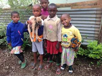 Children holding stray puppy