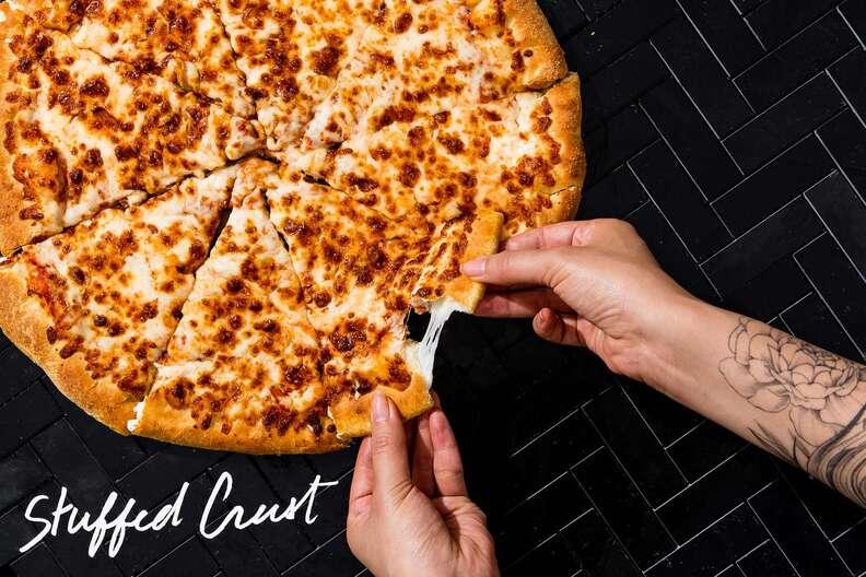 Stuffed crust pizza, cheese pull
