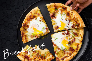 breakfast pizza with eggs and bacon