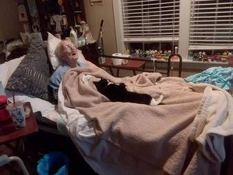 Cat cuddling with sick woman