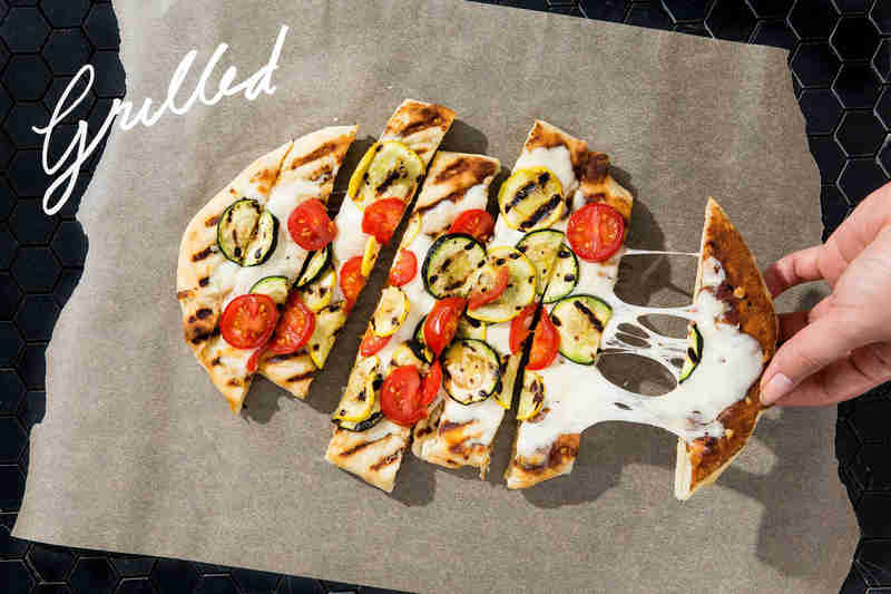 grilled pizza with tomatoes and zucchini