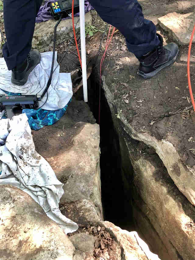 Rescuers trying to reach puppy at bottom of hole