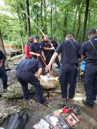Police and firefighters trying to save dog