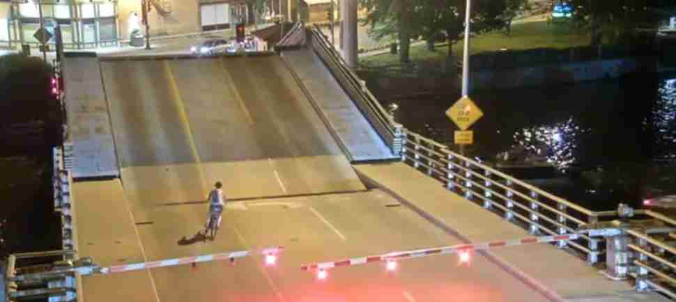Bicyclist Ignores Drawbridge Warning Gates, Plunges Through Drawbridge Gap