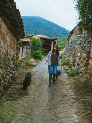 Woman walking with two dogs
