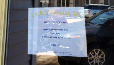Sign on door of puppy