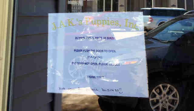 Sign on door of puppy