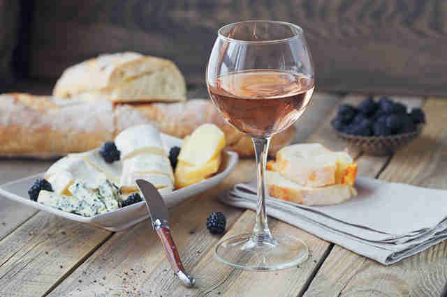 rosé and cheese, bread, and berries