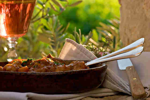 provence stew and glass of rosé wine