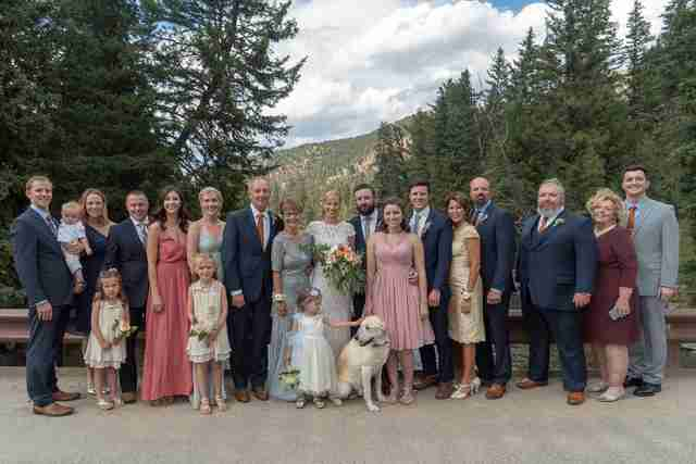 Wedding party posing with dog
