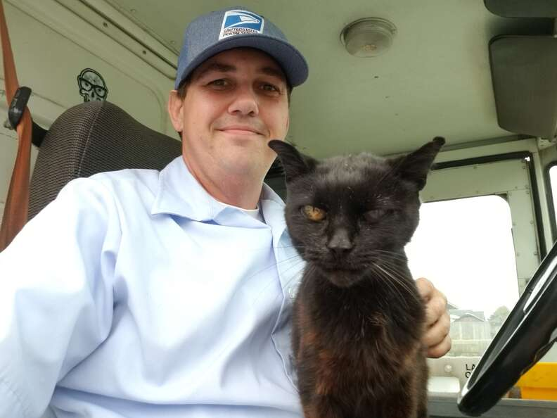 Mike McEuen the mail carrier and cat Bijou