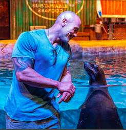 The Rock posing with captive seal