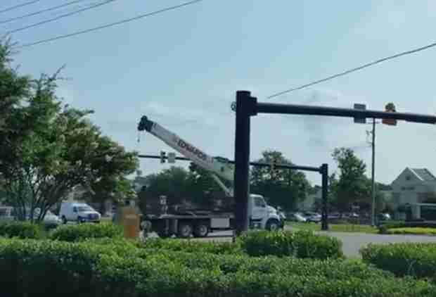 Watch This Truck Driver Accidentally Demolish an Intersection With a Crane