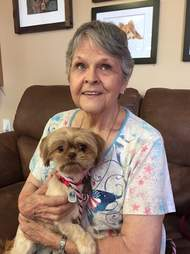 Older woman holding newly adopted dog