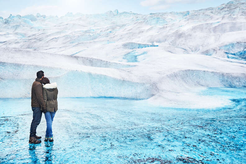 Couple in front of Mendenhall Glacier snowdrift
