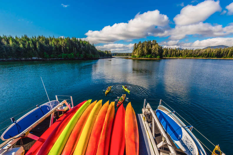 Kayaks stacked on stern of larger boat, Inside Passage, southeast Alaska