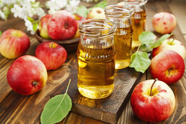 apple juice on the table  with apples