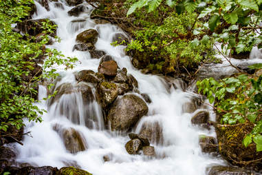 """A waterfall on the """"Trail of Time"""" hiking trail at Mendenhall Glacier"""