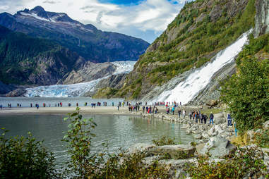 People gathered around Nugget Falls in Mendenhall Glacier