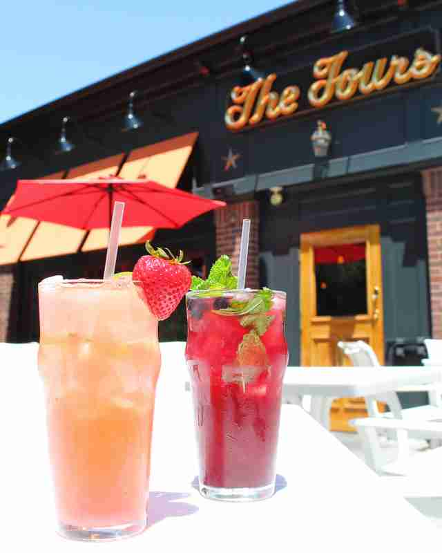 The Fours Restaurant fruity cocktails in front of sign