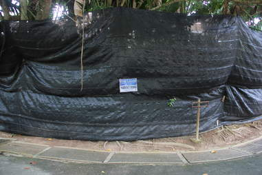 Tarp over closed zoo enclosure