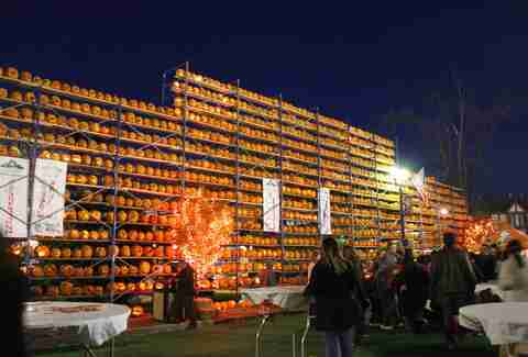 Great Highwood Pumpkin Festival towering shelves of jack-o-lanterns at night