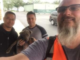 Michael Ortega shows off dog on train