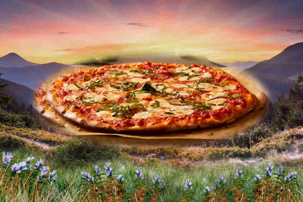 Pizza in front of sunset and meadow