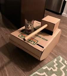 man builds cat a tank