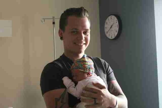 Korey Taphouse holds his newborn daughter
