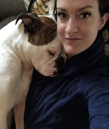 Emily Taphouse holds her English bulldog, Juno