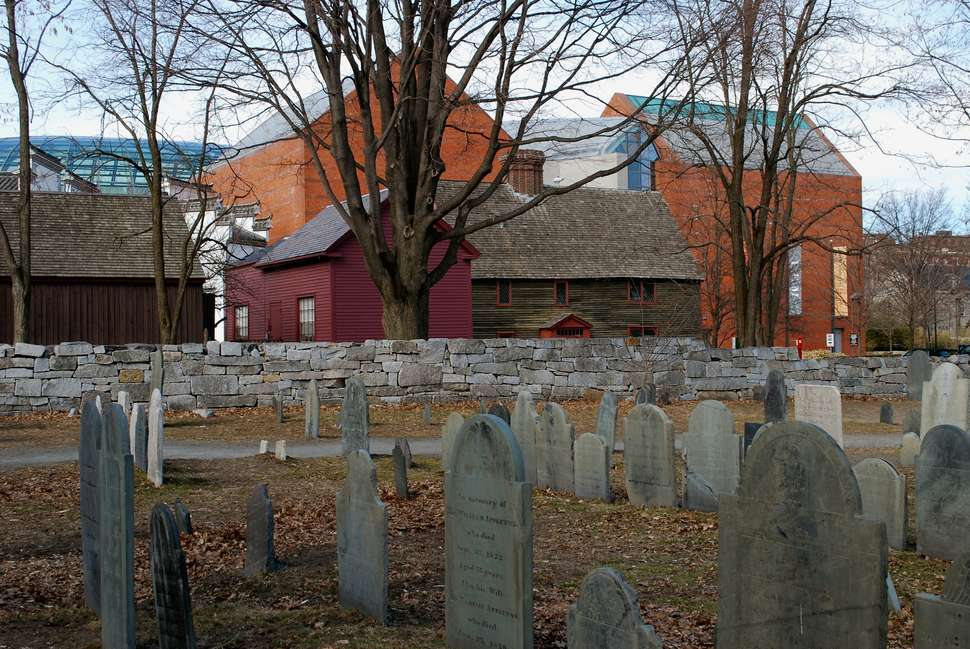 Salem graveyard in front of saltbox-style buildings