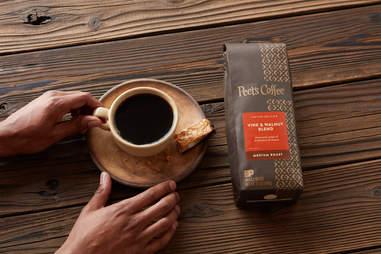 Peet's Coffee bag of beans and coffee mug
