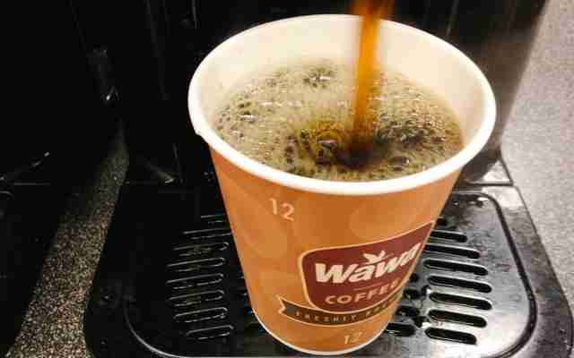 Wawa coffee being poured from coffeemaker into cup