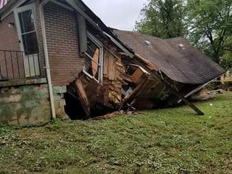 Collapsed house due to flash flooding