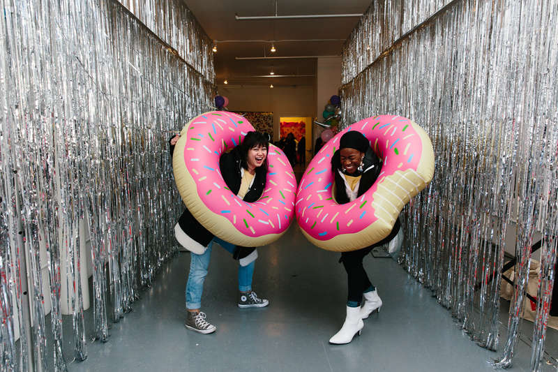 Girls in inflatable doughnuts