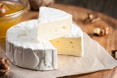 Really soft cheese on a piece of paper
