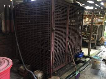 Cage in Vietnam bile farm containing captive moon bear for 17 years