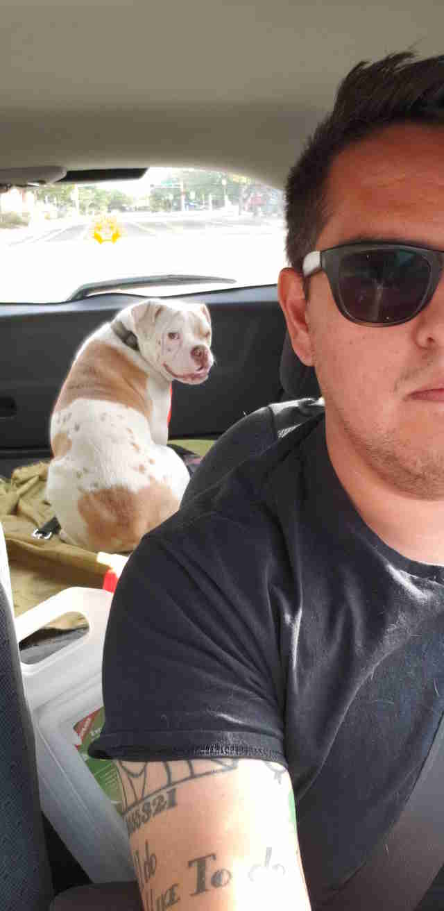 animal control officer adopts dog he rescued
