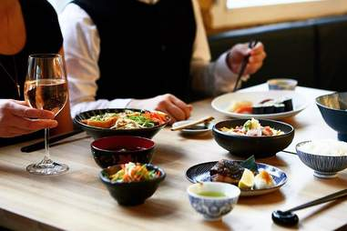 table with diners and sushi