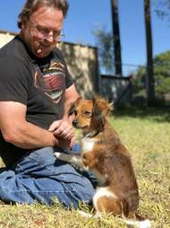 Man with rescued puppy