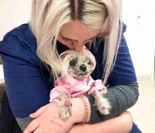 Bianca Stockley kisses her foster dog Martha