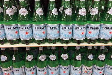 Bottles of San Pellegrino on shelf