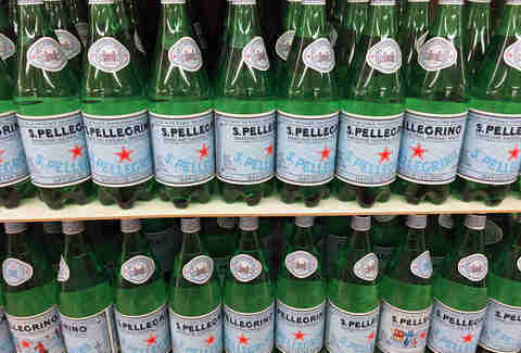 Bottles of San Pellegrino on shelf