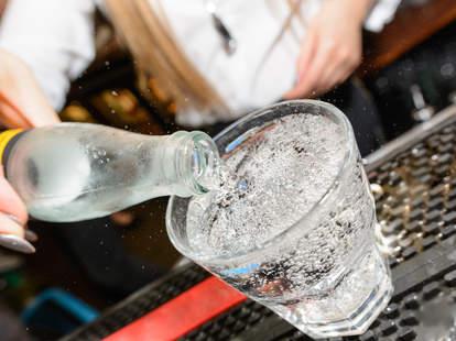 club soda poured at bar