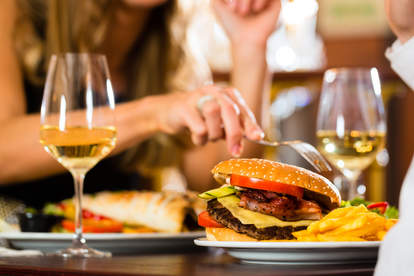 white wine glasses and hamburger on table