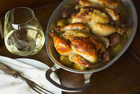 Cornish hens with a glass of white wine.