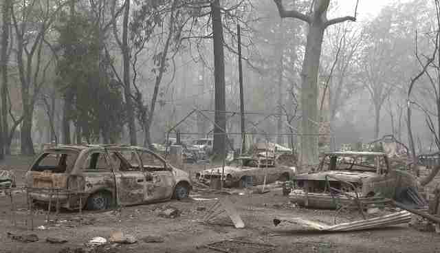 Rescuers In Ruins Of Wildfire Hear Cries For Help Under Burned-Out Truck